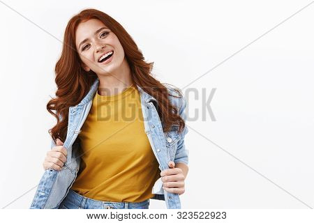 Beauty, Fashion And Women Concept. Happy Attractive Stylish Redhead Woman In Denim Jacket, Showing Y