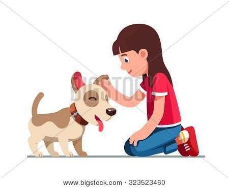 Preschool Girl Sitting On Ground And Patting Dog