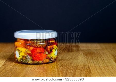 Chevre Cheese In Aromatic Oil With Spices In A Jar. Farm Goat Cheese Chevre In Balls