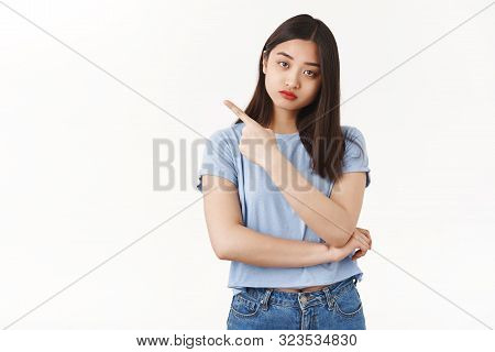 Upset Indifferent Cute Moody Asian Girlfriend Frowning Look Reluctant Unamused Pointing Upper Left C
