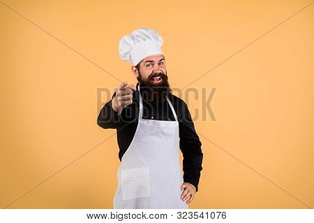 Chef Man. Happy Male Chef With Beard, Mustache Shows Finger On You. Cook Points Forward. Cook In Uni