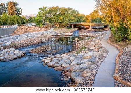 Poudre River and newly constructed whitewater park in downtown of Fort COllins, COlorado, fall scenery with a low water flow