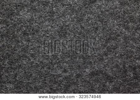 Close-up Fibrous Felt Texture. Gray And White Textured Background. Surface Of Felted Fabric Backdrop