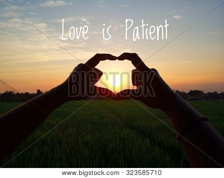 Inspirational Quote-love Is Patient. With Young Girl Making Heart Shape During Sun Rise, Heart Shape