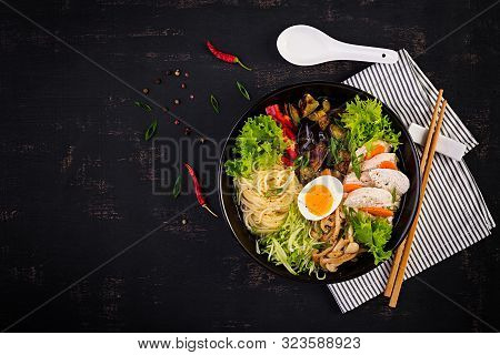 Japanese Ramen Soup With Chicken, Egg, Shimeji Mushrooms And Eggplants On Dark Wooden Background. Ch