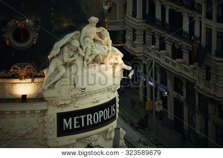 MADRID, SPAIN – MAY 13, 2018: Closeup view of the statue over the Metropolis Building or Edificio Metropolis in Gran Via shopping street.