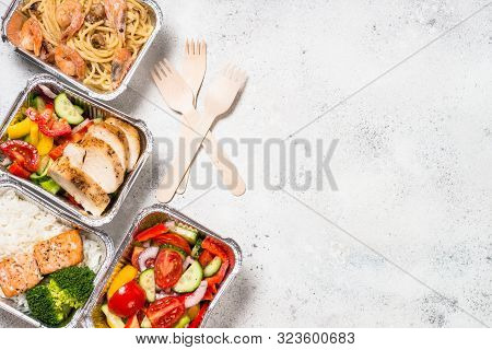 Food Delivery. Different Aluminium Containers With Healthy Diet Natural Food. Top View On White Back