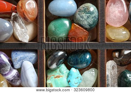 Box With Different Beautiful Gemstones As Background, Top View