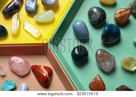 Plastic Tray With Different Beautiful Gemstones As Background, Top View