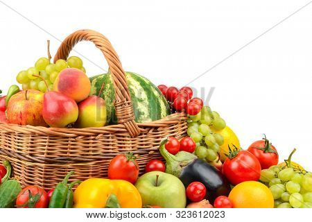 Fresh fruits and vegetables in basket isolated on white background