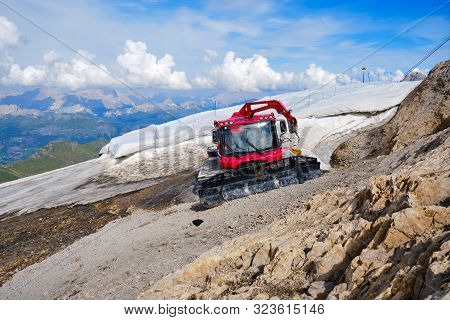 Marmolada Glacier, Italy - August 28, 2019: Pistenbully Snow Groomer Machine Parked Next To The Rema