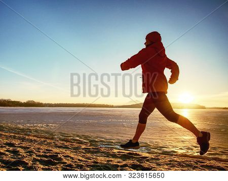 Woman Jogging On Winter Beach Run. Female Athlete Runner Jogger Training Living Healthy Active Exerc