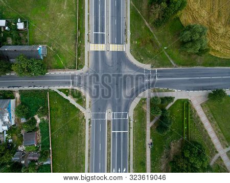 Top View Asphalt Road, A Crossroads In The Village On A Bright Sunny Day. Aerial Photo Of Transport
