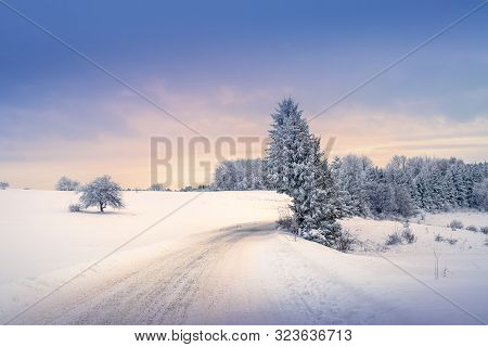 Winter Landscape In Sunset. Mountain Landscape In Winter. Winter Sunset. Road Under Snow In Sunset.
