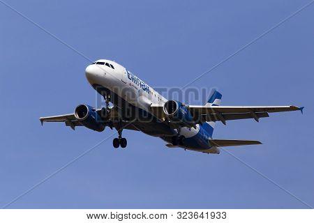 Borispol, Ukraine - September 08, 2019: Sx-emb Ellinair Airbus A319-133 Aircraft On The Blue Sky Bac