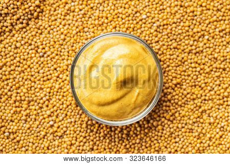 Yellow mustard and mustard seeds. Top view.