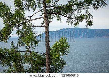 Angara River At Lake Baikal In Listvyanka Village. Summer Landscape On Port Baikal With Mountain Che