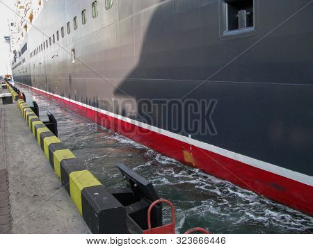 Cruise Liner Is Sailing Off The Pier Under Its Own Power, Auxiliary Thrusters Are Working