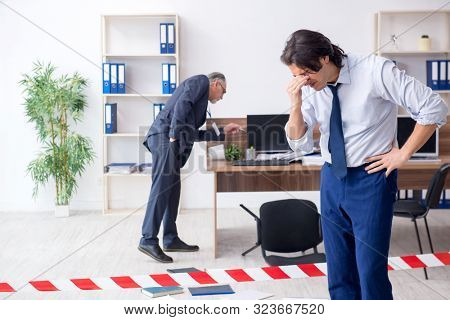 Forensic investigator investigating theft in the office