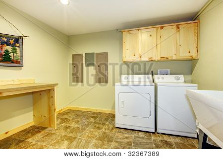 Laundry Roon With Sink And Folding Desk.