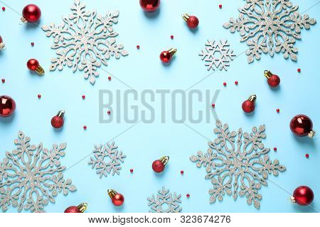 Flat Lay Composition With Christmas Decorations On Light Blue Background