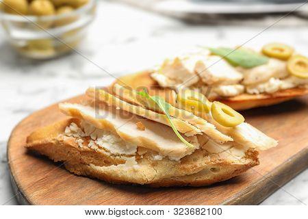 Board With Delicious Chicken Bruschettas On Table, Closeup