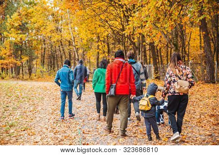 Group Of People Walking By Autumn Forest Trail Families Activities