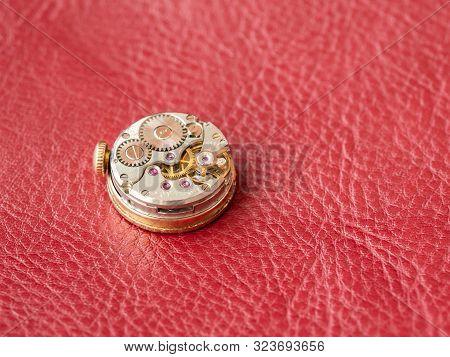 Clockwork Background. Close Up Of Old Clock Watch Mechanism. Retro Clockwork Watch Mechanism With Gr