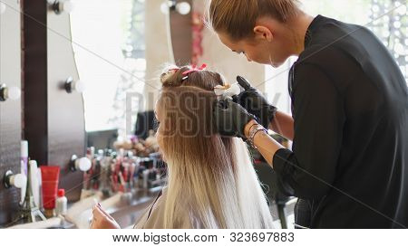 A Hairdresser Is Installing The Upgrade Of Hair Extension.
