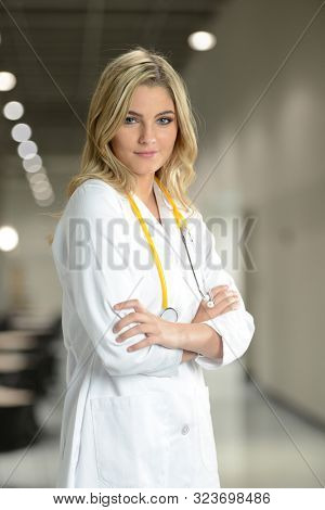 Young Doctor woman at the hospital with her arms crossed