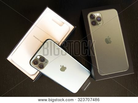 Dubai / Uae - September 21, 2019: New Midnight Green Apple Iphone 11 Pro In Original Box Isolated On