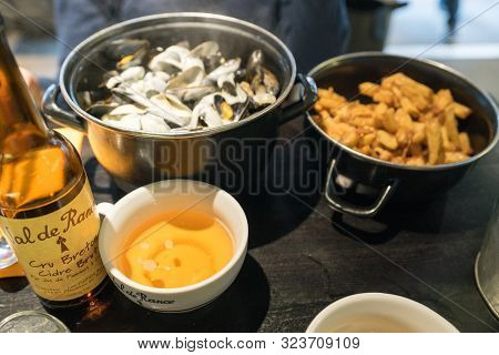 Dinan, Cotes-d-armor / France - 19 August 2019: Delicious Traditional Mussels With Roquefort Cheese