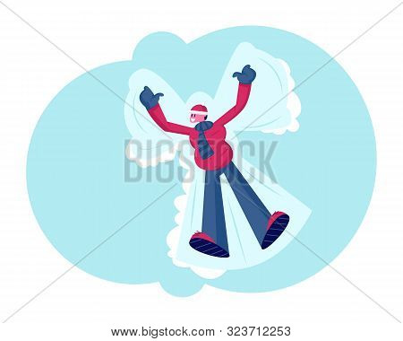 Happy Young Smiling Man Lying Down On Snow-covered Ground Making Snow Angel Spreading Arms And Legs