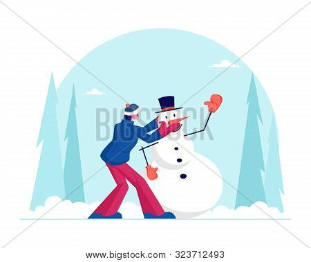 Traditional Winter Time Activity. Man Build Snowman On Street Having Fun Recreational Activity. Male