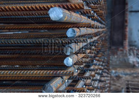 Industrial Background. Rebar Texture. Rusty Rebar For Concrete Pouring. Steel Reinforcement Bars. Co