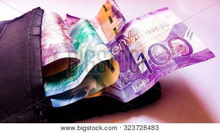 Nairobi, Kenya - September 18: Different Values Of Kenya Bank Notes Emerging From A Black Wallet Tak