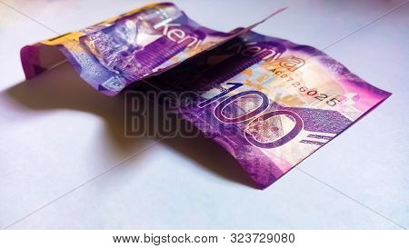 Nairobi, Kenya - September 18: 2 Notes Of 100 Kenya Bank Notes On White With One On Top Of The Other
