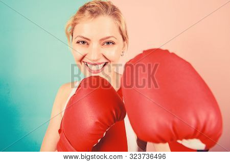 Confident In Her Boxing Skill. Boxing Improve Temper And Will. Concentrated On Punch. Woman Boxing G