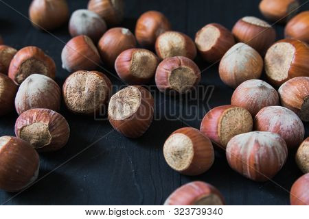 Hazelnuts. Food Background. Photo Wallpaper. Hazelnuts. Stack Of Hazelnuts. Heap Of Peeled Hazelnuts