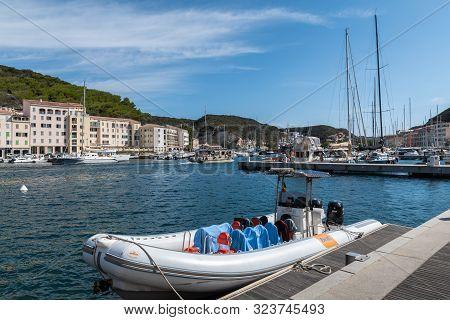 Bonifacio, Corsica - September, 2019. Motor Boat In The Port At The Pier