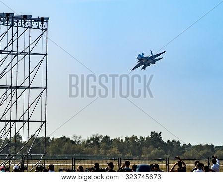 Russian Fighter Aircraft And Spectators In The Stands