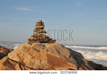 Rock Pile At Bass Rocks In Gloucester, Massachusetts, With Surf From Hurricane Humberto In The Backg
