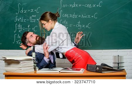 Protecting Himself. Sexy Woman Abusing Bearded Man In Class. Man Victim In Harassing Relationship. V