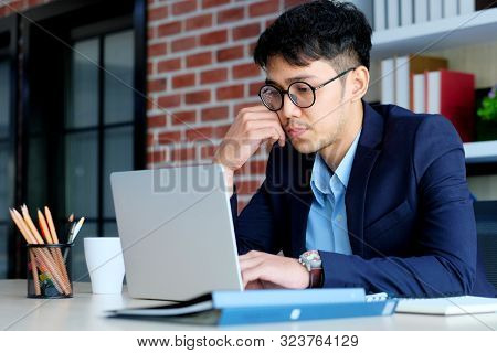 Young Asian Office Man Struggle With Laptop Computer, Frustrated Asian Business Man Looking At Compu