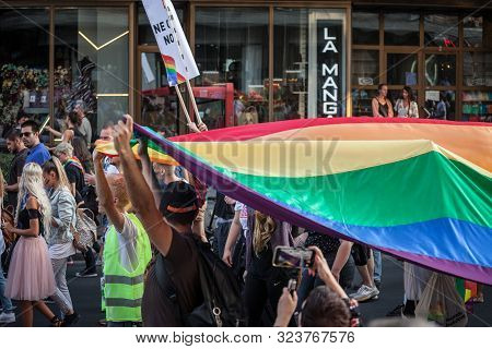 Belgrade, Serbia - September 15, 2019:  Crowd Of Protestors Holding A Giant Rainbow Gay Flag During