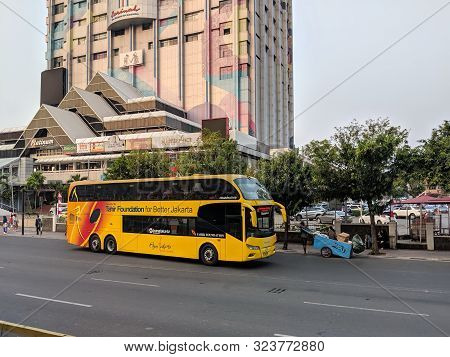 Jakarta, Indonesia - August 3, 2019: Transjakarta Bus Passing On Thamrin Street In Front Of Sarinah
