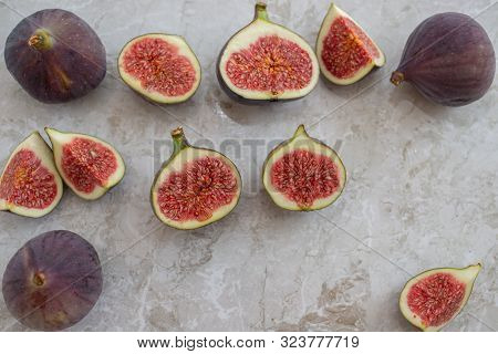 Fresh Figs. Whole Figs And Sliced In Half Figs In Ceramic Bowl.