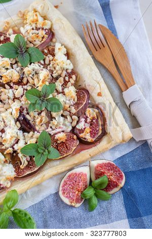 Home Made Tart With Figs And Cheese On A Table