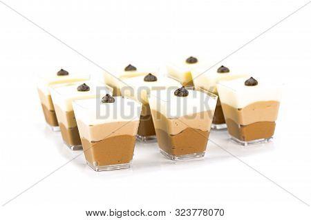 Tiramisu Dessert With Chocolate Bar And Cocoa Powder Isolated On White Background. Traditional Tiram