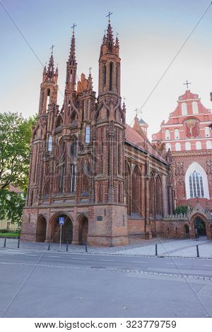 VILNIUS, LITHUANIA - JULY 30, 2019:  Facade of Roman Catholic Church of St. Anna in Vilnius (lit. Church of the Holy Onos) and  Church Of St. Francis And St. Bernard, UNESCO World Heritage